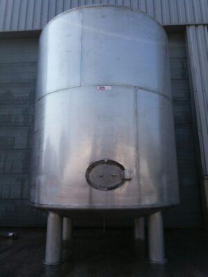 used vertical stainless steel tank on 4 feet