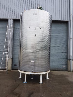 Used stainless steel tank with agitator on steel legs